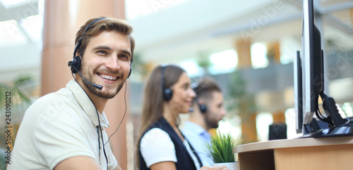 Fotografía Attractive positive young businesspeople and colleagues in a call center office