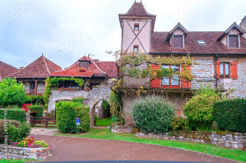 Fotografie, Tablou Medieval village of Aquitaine with its stone houses in the south of France on a cloudy day