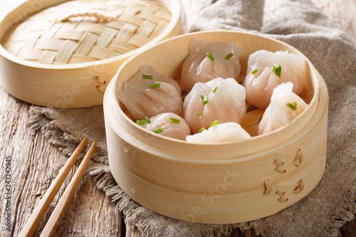 Steamed shrimp dumplings dim sum  close-up on the table. horizontal