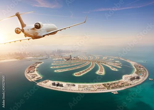 Private jet plane flying above Dubai city