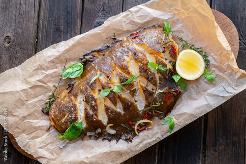 Canvastavla baked flounder fish whole with seasonings, lemon and Basil on parchment, top vie