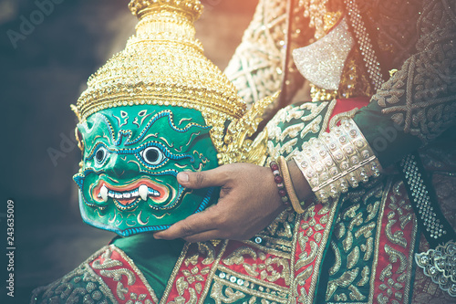 A burly young man who shaped the role of the Asian Thunder Giant from Ramayana compositions are holding mask in hand Fototapeta