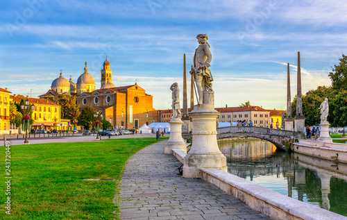 Wallpaper Mural View of canal with statues on square Prato della Valle and Basilica Santa Giusti