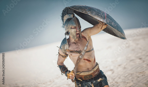 Fotografia, Obraz Male athlete in the armor of an ancient warrior