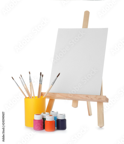 Fotografie, Tablou Wooden easel with blank canvas board and painting tools for children on white ba