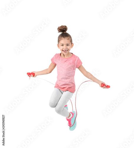 Full length portrait of girl jumping rope on white background