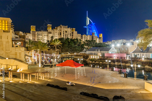 Night view of Burj Al Arab (Tower of the Arabs) seen from Madinat Jumeirah in Du Fototapeta