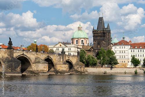 Obraz na płótnie Bank of Vltava river and view ob Charles bridge in Prague, Czech Republic