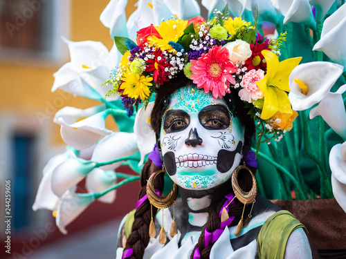 Portrait of a woman wearing beautiful Day of the Dead costumes and skull makeup in Guanajuato, Mexico.