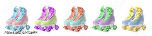 Set with stylish quad roller skates on white background