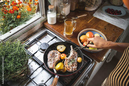 Chef cooking steak in a kitchen food photography recipe idea