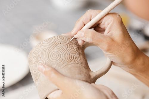 Fényképezés Close up of a woman making ceramic and pottery