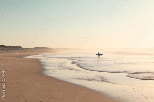 Peniche - Portugal - 26 September 2018 - Surfer running on the beach