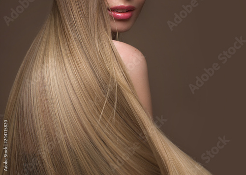 Carta da parati Beautiful blond girl with a perfectly smooth hair, classic make-up