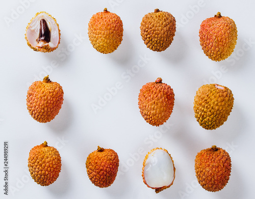 Tropical abstract background. Lychee on the white background.
