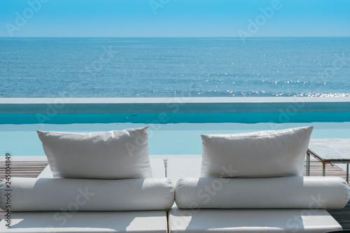 luxury swimming pool on sea view and beach chair in hotel resort Fototapeta