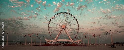 Fotografia Seafront boulevard and round wheel