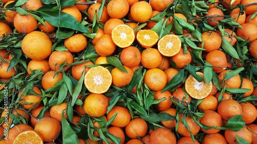 Orange fruit with leaves for sale on market
