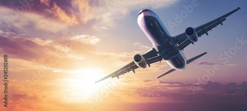 modern aircraft against a sunset