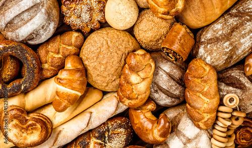 Fotografia Fresh fragrant bread on the table. Food concept