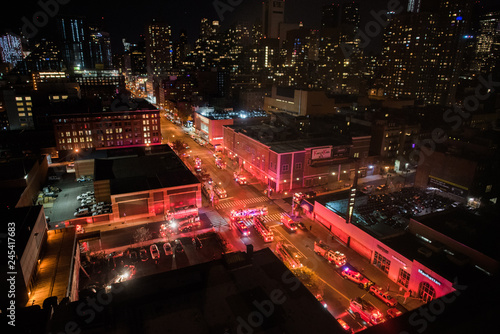 Valokuvatapetti 3-alarm fire in New York City with fire trucks viewed from above
