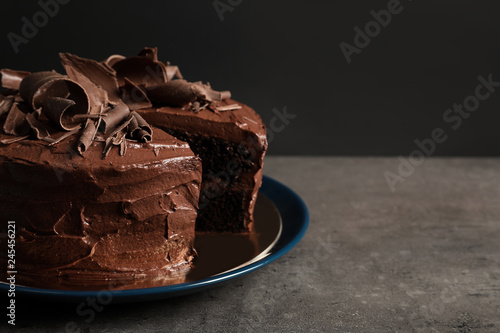 Tasty homemade chocolate cake on table. Space for text