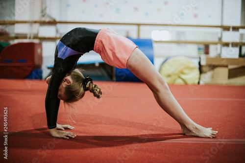Young gymnast doing a bridge pose