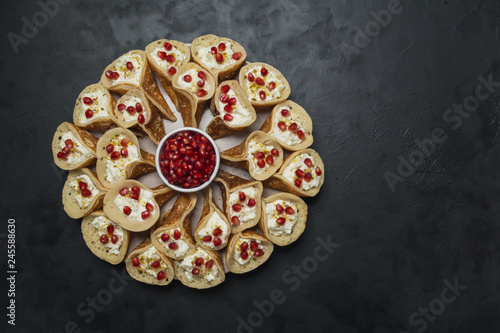 Pomegranate Qatayef Asafiri, Arabian pancake stuffed with sweet cheese.