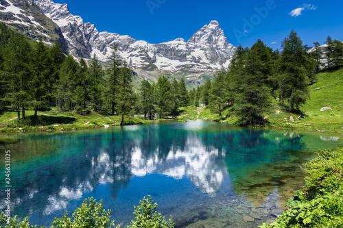 Fotografia, Obraz Summer alpine landscape with the Matterhorn (Cervino) reflected on the Blue Lake