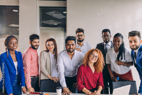 young and successful mixed race business people looking at camera, friendship, cooperation, team