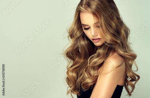 Murais de parede blonde girl with long  and   shiny wavy hair