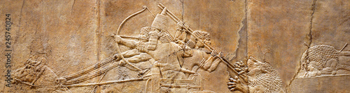 Fotografía Assyrian wall relief of lion hunt, ancient history of Babylon and Shumer