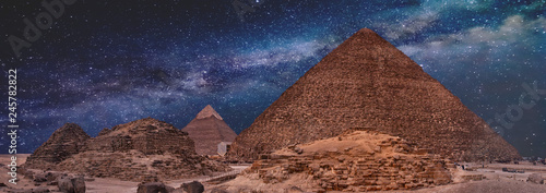 Fotografie, Obraz Night sky of the Milky Way over the great pyramids on the plateau of Giza, Egypt, Africa