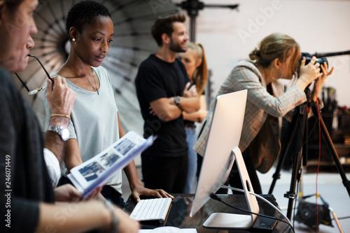Canvas Print Art director checking the photos on a monitor