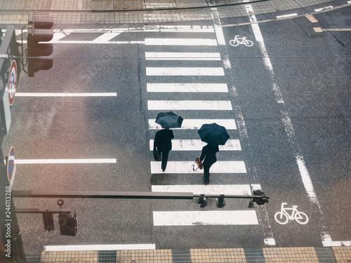 Fotomural People walk on street Aerial view crosswalk Traffic sign in Raining day
