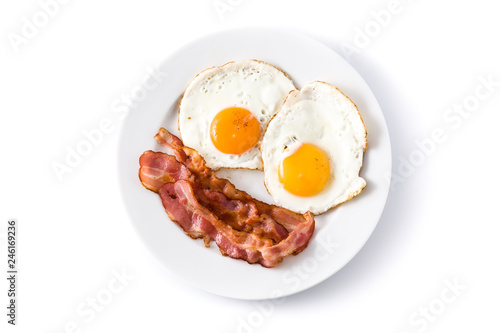 Fried eggs and bacon for breakfast isolated on white background. Top view