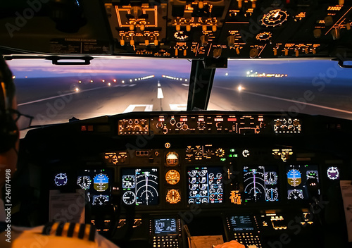 Fotografie, Tablou Cockpit of a passenger plane. View from the cockpit during