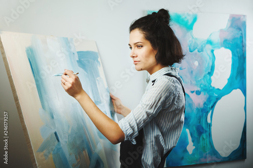 Vászonkép Concentrated girl focused on creative art-making process in art therapy
