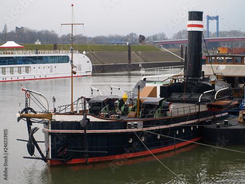 Fototapeta vintage steam ship in the port of Duisburg