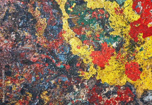 Abstractionism painting randomly formed by colored paint stains.