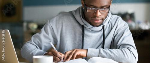 Foto Closeup smart millennial african student wear glasses hold pen noting writing do