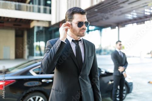 Obraz na płótnie Protection Officer Wearing Suit On Street