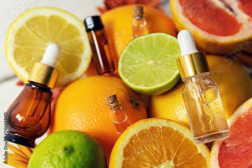 Fotografiet citrus fruit essential oils and cosmetics