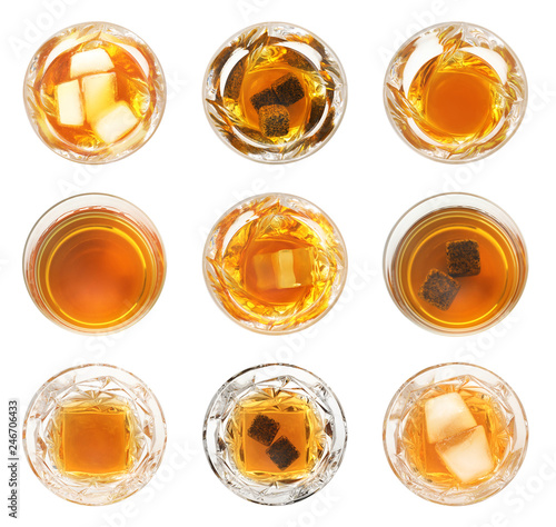 Set of glasses with expensive whiskey on white background, top view