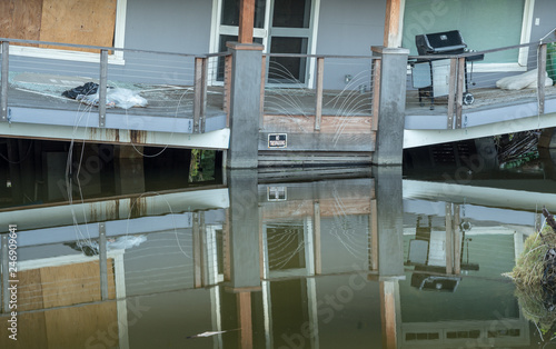 Obraz na plátně Balcony of beach home sinking into sink hole after the massive rain storms of Ap