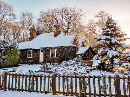 Fototapeta Winter snow covered village cottage in England