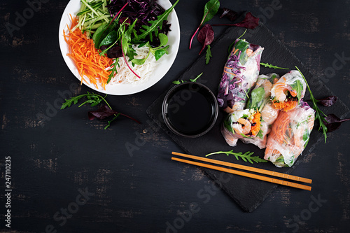Vegetarian vietnamese spring rolls with spicy shrimps, prawns,  carrot, cucumber, red cabbage and rice noodle. Seafood. Tasty meal.  Top view, flat lay, copy space