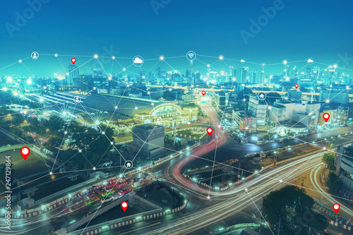 Smart city and wireless communication network technology and communication icon over panorama of cityscape buildings and skyscrapers of downtown luxury hotel with blue sky in bangkok thailand.