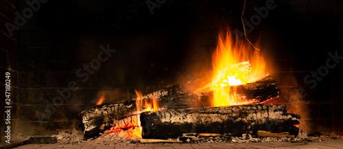 Obraz na plátne A glowing fire in the stone fireplace