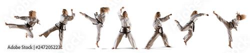 Photo Caucasian female in kimono practicing taekwondo